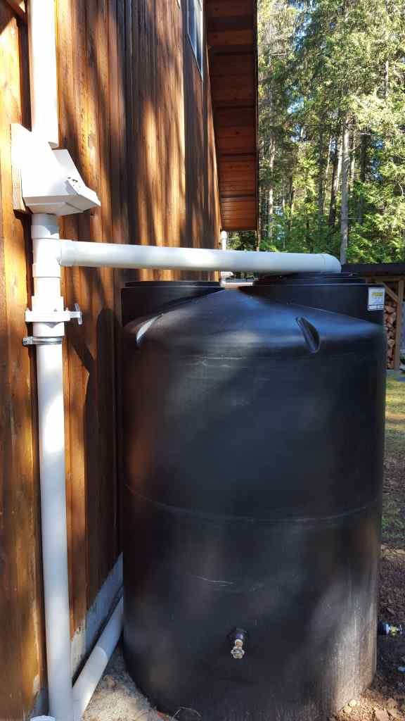 Image of Cistern install besides house